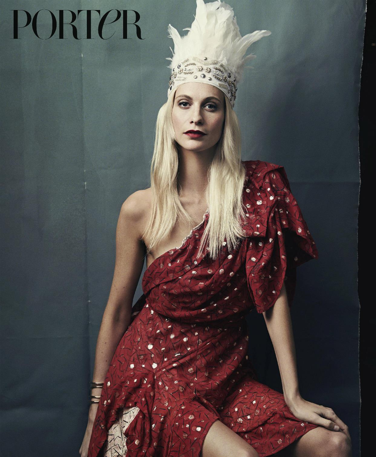 Poppy Delevingne wears dress by Andreas Kronthaler for Vivienne Westwood, headdress by Curious Fare and cuff...